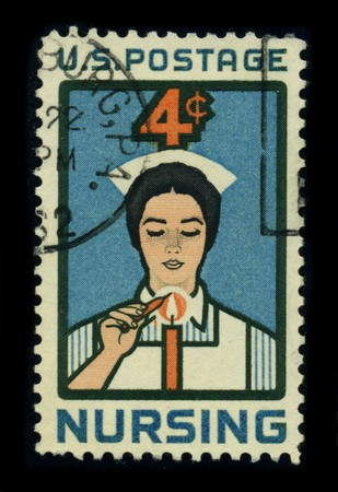 USA-CIRCA 1962: A stamp dedicated to the Nursing is a healthcare profession focused on the care of individuals, families, and communities so they may attain, maintain, or recover optimal health and quality of life from birth to death, circa 1980. Stock Photo - 8322952