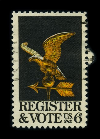 democracies: USA - CIRCA 1980: A stamp dedicated to the Voter registration is the requirement in some democracies for citizens and residents to check in with some central registry specifically for the purpose of being allowed to vote in elections, circa 1980.