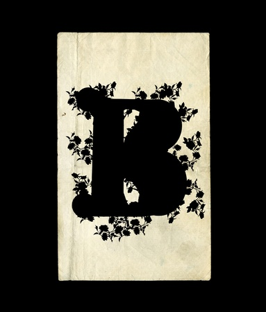 An initial letter B in the old background. photo