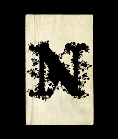 An initial letter N in the old background. photo