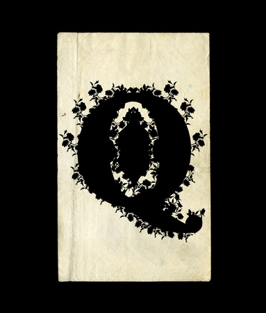 An initial letter Q in the old background. photo
