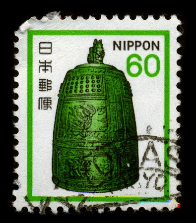JAPAN - CIRCA 1970: A stamp dedicated to the Dotaku are Japanese bells smelted from relatively thin bronze and richly decorated, circa 1970. Stock Photo - 8568103
