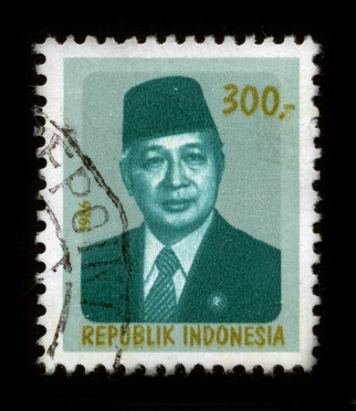 mediaval: INDONESIA - CIRCA 1986: A stamp dedicated to the Suharto (8 June 1921 - 27 January 2008) was the second President of Indonesia, having held the office for 32 years from 1967 following Sukarnos removal until his resignation in 1998, circa 1986.