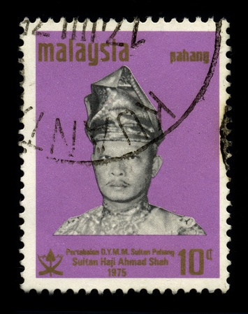 pekan: MALAYSIA - CIRCA 1975: A stamp dedicated to the HRH Sultan Haji Ahmad Shah ibni Sultan Abu Bakar Riayatuddin Al-Muadzam Shah (born 24 October 1930 at Istana Mangga Tunggal, Pekan), circa 1975. Editorial