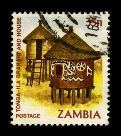 dedicated: ZAMBIA - CIRCA 1980: A stamp dedicated to the Tonga granary and house, circa 1980.