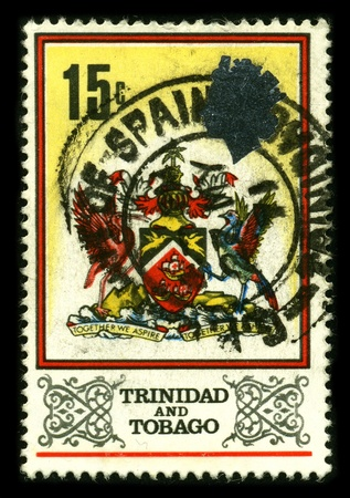 TRINIDAD AND TOBAGO - CIRCA 1980: A stamp dedicated to The Coat of Arms of Trinidad and Tobago was designed by a committee formed in 1962 to select the symbols that would be representative of the people of Trinidad and Tobago, circa 1980. Stock Photo - 8645092