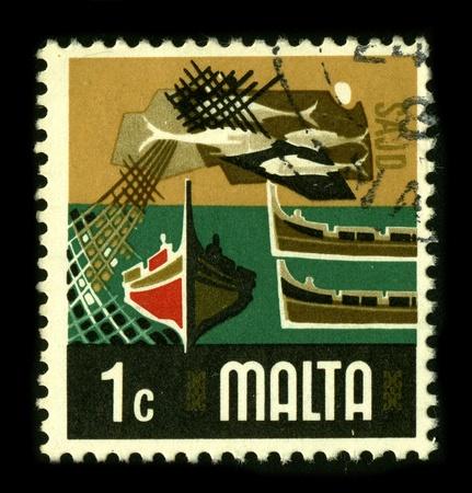 fishing fleet: MALTA - CIRCA 1980: A stamp dedicated to the Maltas fishing fleet, circa 1980.
