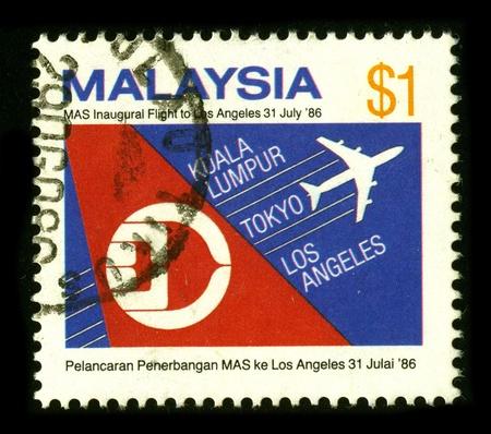 abbreviated: MALAYSIA - CIRCA 1986: Un francobollo dedicato a la Malaysia Airlines System Berhad, DBA Malaysia Airlines (abbreviata MAS), � la compagnia di bandiera di propriet� del governo della Malesia, circa 1986.