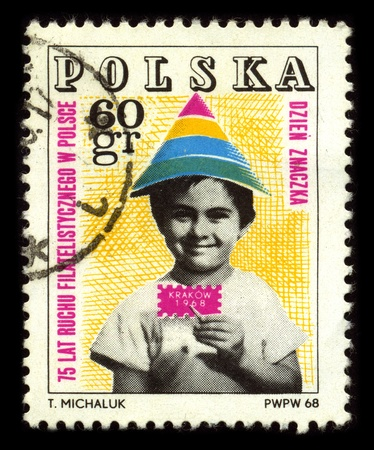papoose: POLAND-CIRCA 1968:A stamp printed in POLAND shows image of the 75 years of Polish stamps, circa 1968. Editorial
