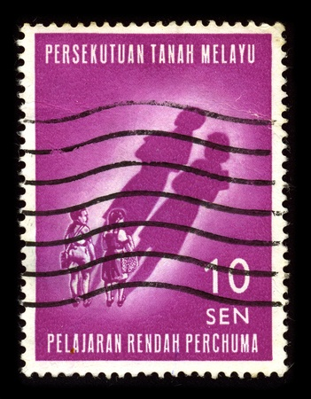 sissy: MALAYSIA-CIRCA 1980:A stamp printed in MALAYSIA shows image of the Malaysian children, circa 1980.