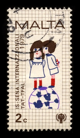 papoose: MALTA-CIRCA 1979:A stamp printed in MALTA shows image of the Child protection, circa 1979.