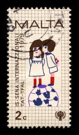 MALTA-CIRCA 1979:A stamp printed in MALTA shows image of the Child protection, circa 1979.