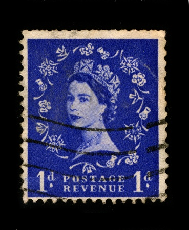 UNITED KINGDOM - CIRCA 1960: An English Used First Class Postage Stamp printed in UNITED KINGDOM showing Portrait of Queen Elizabeth in blue, circa 1960.