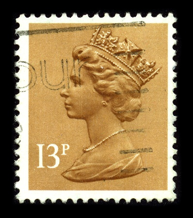 UNITED KINGDOM - CIRCA 1990: An English Used First Class Postage Stamp printed in UNITED KINGDOM showing Portrait of Queen Elizabeth in orange, circa 1990.