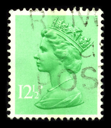UNITED KINGDOM - CIRCA 1990: An English Used First Class Postage Stamp printed in UNITED KINGDOM showing Portrait of Queen Elizabeth in green, circa 1990.