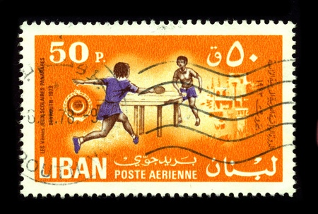 back and forth: LEBANON-CIRCA 1978:A stamp printed in LEBANON shows image of the Table tennis, also known as ping-pong, is a sport in which two or four players hit a lightweight, hollow ball back and forth using table tennis racketsl, circa 1978.