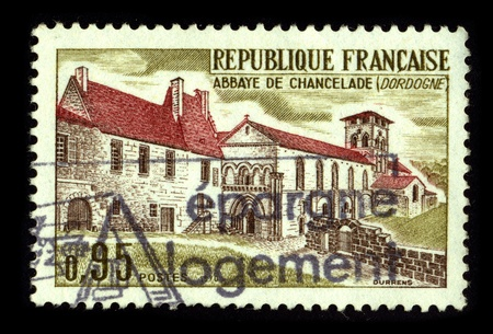 FRANCE-CIRCA 1980:A stamp printed in FRANCE shows image of The Abbey is an abbey Chancelade French Romanesque style situated on the town Chancelade in the Dordogne, circa 1980. Stock Photo - 8757376