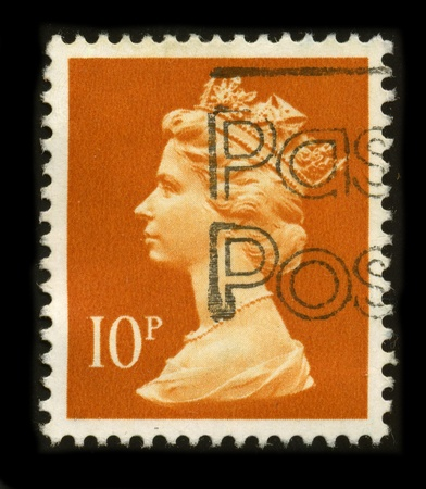 UNITED KINGDOM - CIRCA 1996: An English Used First Class Postage Stamp printed in UNITED KINGDOM showing Portrait of Queen Elizabeth in red, circa 1996.