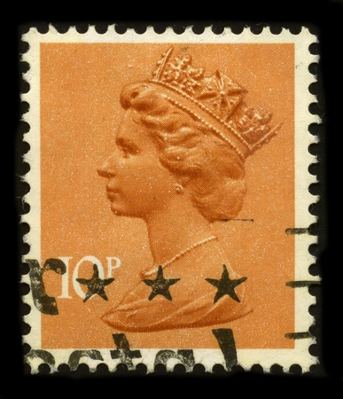 UNITED KINGDOM - CIRCA 1996: An English Used First Class Postage Stamp printed in UNITED KINGDOM showing Portrait of Queen Elizabeth in orange, circa 1996.
