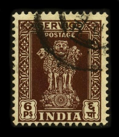 ashoka: INDIA-CIRCA 1960:A stamp printed in INDIA shows image of The emblem of India is an adaptation of the Sarnath Lion Capital of Ashoka, circa 1960.