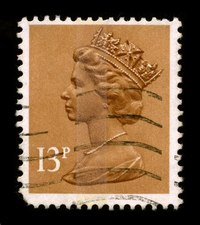 UNITED KINGDOM - CIRCA 1996: An English Used First Class Postage Stamp printed in UNITED KINGDOM showing Portrait of Queen Elizabeth in yellow, circa 1996.