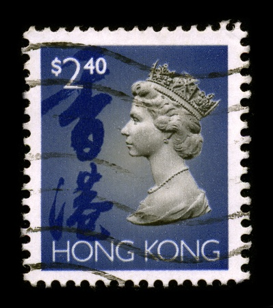 HONG KONG - CIRCA 1990: An Hong Kong Used First Class Postage Stamp printed in HONG KONG showing Portrait of Queen Elizabeth in blue, circa 1990. Stock Photo - 8844340