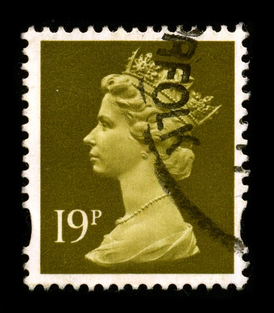 UNITED KINGDOM - CIRCA 1990: An English Used First Class Postage Stamp printed in UNITED KINGDOM showing Portrait of Queen Elizabeth in brown, circa 1990.