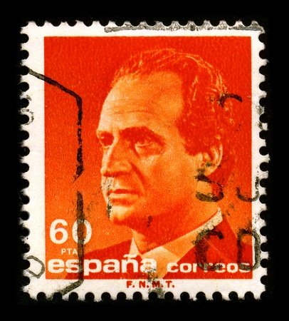 reigning: SPAIN - CIRCA 1990: A stamp printed in SPAIN shows image portrait Juan Carlos I (baptized as Juan Carlos Alfonso Victor Maria de Borbon y Borbon-Dos Sicilias; born in Rome, 5 January 1938) is the reigning King of Spain, circa 1990.
