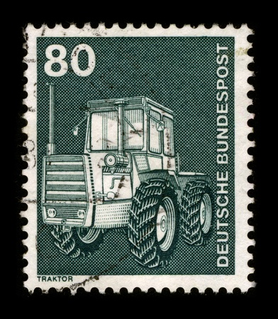 hauling tractor: GERMANY - CIRCA 1981: A stamp of the dedicated to the Tractor is a vehicle specifically designed to deliver a high tractive effort (or torque) at slow speeds, for the purposes of hauling a trailer or machinery used in agriculture or construction, circa 19