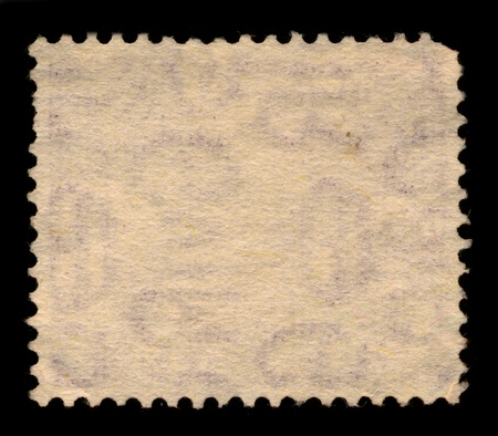 The reverse side of a postage stamp. photo