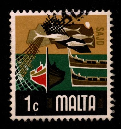 malta: MALTA-CIRCA 1960:A stamp printed in MALTA shows image of the fishing industry of Malta, circa 1960. Editorial