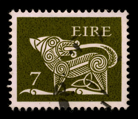 eire: EIRE - CIRCA 1980: A stamp dedicated to The dog (Canis lupus familiaris) is a domesticated form of the gray wolf, a member of the Canidae family of the order Carnivora, circa 1980.