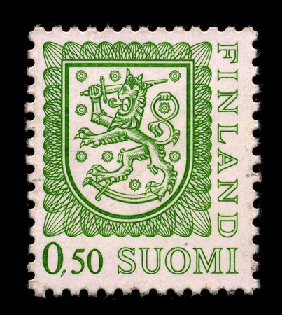 FINLAND-CIRCA 1950:A stamp printed in FINLAND shows image of The Coat of arms of Finland is a crowned lion on a red field, the right forepaw replaced with an armoured hand brandishing a sword, trampling on a saber with the hindpaws, circa 1950.