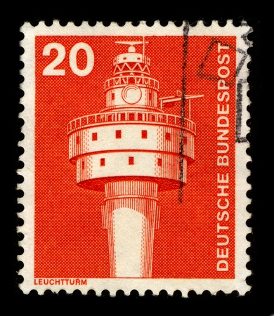 inland waterways: GERMANY-CIRCA 1980:A stamp printed in GERMANY shows image of the lighthouse is a tower, building, or other type of structure designed to emit light from a system of lamps and lenses or, in older times, from a fire, and used as an aid to navigation for pil