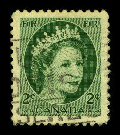 CANADA - CIRCA 1960: An English Used First Class Postage Stamp printed in CANADA showing Portrait of Queen Elizabeth in green, circa 1960.