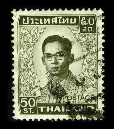 THAILAND - CIRCA 1950: A stamp printed in USA shows image portrait Bhumibol Adulyadej (Royal Institute: Phumiphon Adunyadet born 5 December 1927) is the current King of Thailand, circa 1950. Stock Photo - 9144057