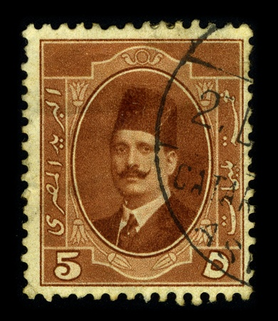 perforated stamp: TURKEY-CIRCA 1920:A stamp printed in TURKEY shows image of the Turkish man in a fez, circa 1920. Editorial