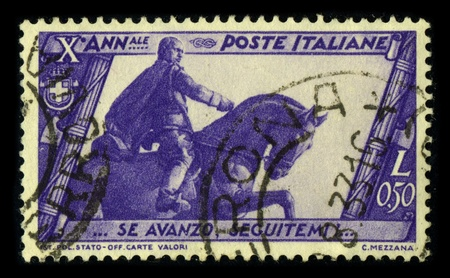 fascist: ITALY-CIRCA 1933:A stamp printed in ITALY shows image of the Benito Amilcare Andrea Mussolini (29 July 1883 - 28 April 1945) was an Italian politician who led the National Fascist Party and is credited with being one of the key figures in the creation of