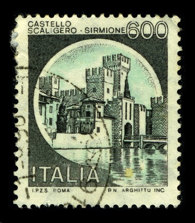 heartiness: ITALY - CIRCA 1990:A stamp printed in ITALY shows image of the Sirmione is a comune in the province of Brescia, in Lombardy (northern Italy), circa 1990.