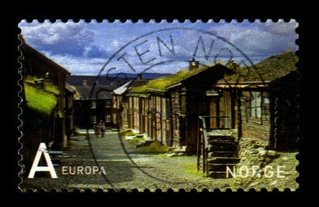 NORWAY-CIRCA 1990:A stamp printed in NORWAY shows image of the Norwegian Village, circa 1990. Stock Photo - 9205118