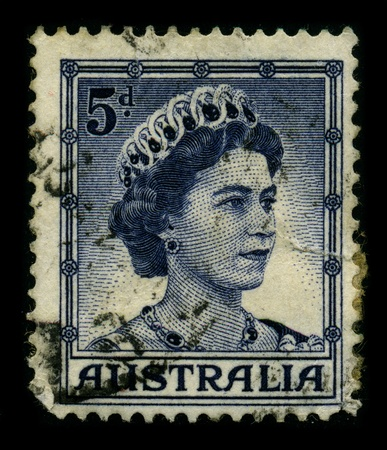 AUSTRALIA-CIRCA 1960:A stamp printed in AUSTRALIA shows image of the Elizabeth II is the constitutional monarch of sixteen independent sovereign states known as the Commonwealth realms: the United Kingdom, Canada, Australia, New Zealand, Jamaica, Barbados Stock Photo - 9205109