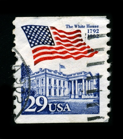 USA-CIRCA 1992:A stamp printed in USA shows image of The national flag of the United States of America (the American flag) consists of thirteen equal horizontal stripes of red alternating with white, with a blue rectangle in the canton  bearing fifty sm