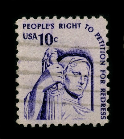 amendment: USA-CIRCA 1960:A stamp printed in USA shows image of the right to petition is guaranteed by the First Amendment to the federal constitution, which specifically prohibits Congress from abridging the right of the people...to petition the Government for a r