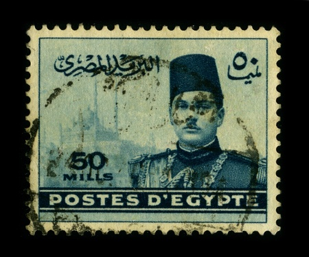 farouk: EGYPT-CIRCA 1950:A stamp printed in EGYPT shows image of Farouk I of Egypt(11 February 1920 - 18 March 1965), was the tenth ruler from the Muhammad Ali Dynasty and the penultimate King of Egypt and Sudan, succeeding his father, Fuad I, in 1936, circa 1950