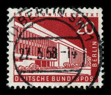 distinguishes: GERMANY-CIRCA 1958:A stamp printed in GERMANY shows image of the Freie Universitat Berlin is one of the leading research universities in Germany and distinguishes itself through its modern and international character, circa 1958. Editorial