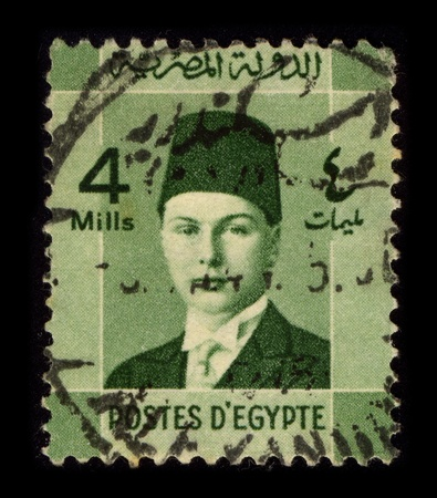 farouk: EGYPT-CIRCA 1937:A stamp printed in EGYPT shows image of Farouk I of Egypt  (11 February 1920 - 18 March 1965), was the tenth ruler from the Muhammad Ali Dynasty and the penultimate King of Egypt and Sudan, succeeding his father, Fuad I, in 1936, circa 19 Editorial