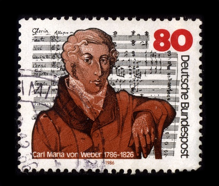 znaczna: GERMANY-CIRCA 1986:A stamp printed in GERMANY shows image of Carl Maria Friedrich Ernst von Weber (18-19 November 1786 - 4-5 June 1826) was a German composer, conductor, pianist, guitarist and critic, one of the first significant composers of the Romantic Publikacyjne