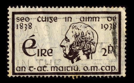 county tipperary: IRELAND-CIRCA 1938:A stamp printed in IRELAND shows image of Theobald Mathew (1790-1856), an Irish teetotalist reformer, popularly known as Father Mathew was born at Thomastown, near Golden, County Tipperary, on October 10, 1790, circa 1938.