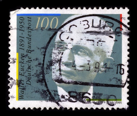 economist: GERMANY-CIRCA 1991:A stamp printed in GERMANY shows image of Walter Eucken (17 January 1891 - 20 March 1950) was a German economist and father of ordoliberalism, circa 1991.