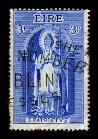 patron saint of ireland: IRELAND-CIRCA 1961:A stamp printed in IRELAND shows image of Saint Patrick was a Romano-Briton and Christian missionary, who is the most generally recognized patron saint of Ireland or the Apostle of Ireland, although Brigid of Kildare and Colmcille are a Editorial